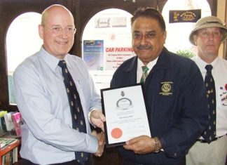 """Graham Macdonald the president of the Royal British Legion Chonburi Thailand presents Peter Malhotra, the managing director of Pattaya Mail Media Group with a """"Friend of the Legion"""" Certificate."""