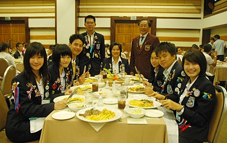 DG Thongchai (standing right) oversees the children during the 'dining etiquette' training session.
