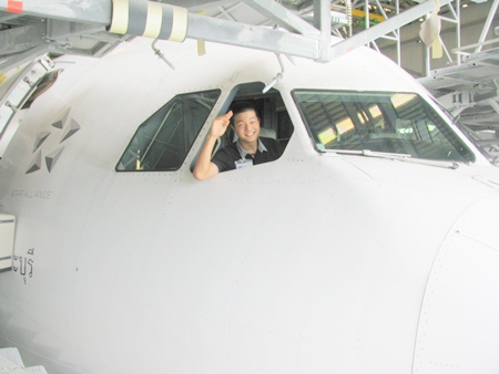 Captain Tee works with Thai Airways maintenance staff at U-Tapao Airport.