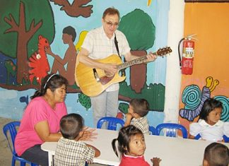 Mr Kevin serenading the Mercy Center children.