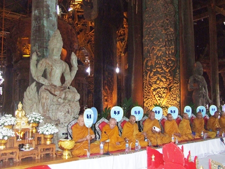 Monks perform ancient Buddhist prayers at the Sanctuary of Truth.