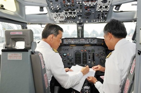 His Royal Highness Crown Prince Maha Vajiralongkorn goes through pre-flight preparations before takeoff on a special Buddhist Pilgrimage Flight he piloted to India.