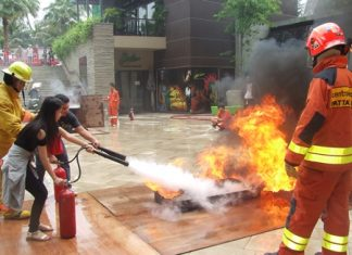 Workers at Central Festival Pattaya Beach are given training and a chance to practice putting out fires.