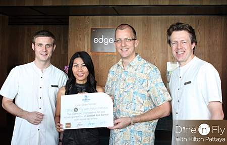Harald Feurstein (2nd right) GM of the Hilton Pattaya presents the 'Dine 'n' Fly' campaign prize to Suwisa Ridphu (2nd left) recently. They are flanked by Simon Bender, F&B Manager (left) and Michel Scheffers, Director of Operations. The prize includes 2 return air tickets to Koh Samui together with 2 nights' accommodation at the Conrad Koh Samui. The campaign continues until September 30 with two more great prizes to be won by spending 3000 baht at any of the hotel's magnificent restaurants.