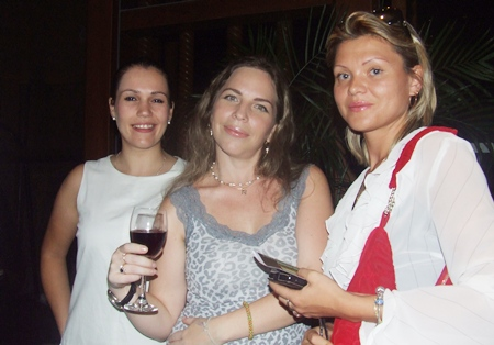 (L to R) Lena Novozhilova, customer service manager for Greendoor Enterprises; Natatia Garipova, managing director of Maxis Enterprises Co., Ltd.; and Jelena Koptilova, head of the Real Estate Department at Topwell Property talk shop over a glass of wine.
