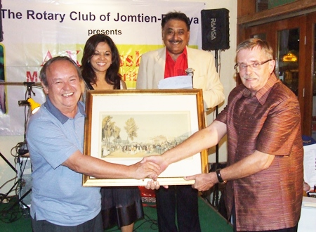 Premprecha Dibbayawan (left) receives his door prize from Martin Brands witnessed by Chitra Chandrasiri (top left) and Peter Malhotra.
