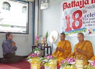 Prince Malhotra represents the Pattaya Mail in leading staff in prayer.