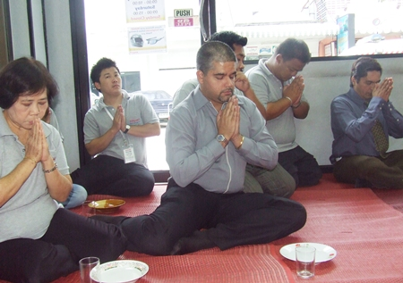 Tony Malhotra leads the staff in deep meditation and prayer.
