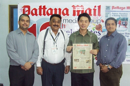 Tony, Peter and Prince pose with newly elected member of parliament Poramase Ngarmpiches holding a copy of the very first issue of the Pattaya Mail published on 23 July 1993.