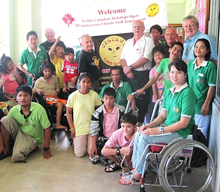 Wayne Ogonoski (center, right) from the Jackalope Open, along with members of the Jesters Care for Kids charity visit the children and care givers at the Lat Krabang facility.