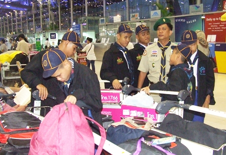 The blind scouts prepare to check their luggage at the airport check-in counters.