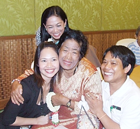 (Clockwise from left) Woranuch Suhsang, Sunne Weawmanee and Pramoal Iamma bring tears of joy to Grandmother Charoen Umphaiwong.