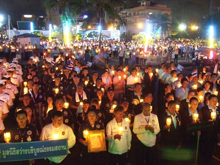 People sing happy birthday and say prayers during a candlelight ceremony at Bali Hai pier.