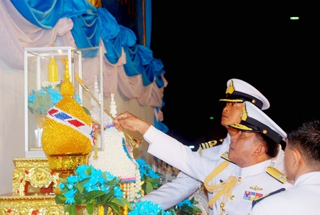 Adm. Narong Teswisan, Commander in Chief of the Royal Thai Fleet, presides over the candle lighting ceremony in Sattahip to bless Her Majesty the Queen.