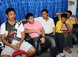 Sampan Kammanee (left) and his crew were arrested for allegedly running an illegal lottery.