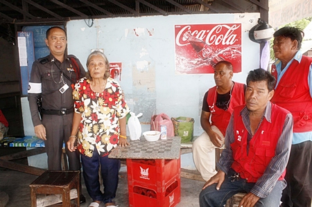 Police officer Ngernpruen Boonserm (left), motorbike taxi driver Vim Chanhorn (right) and friends assist La-ong Aramsuwan (2nd left) in her time of need.