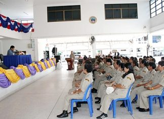 Sattahip District Chief Chaichan Iamcharoen (left) addresses the city's latest civil defense volunteer trainees.