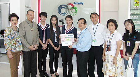 At a handover ceremony held at the newly opened Amway Center, Preecha Prakopkit (2nd from left), managing director of Amway (Thailand) Company along with his spouse and staff donated 100,000 baht to the Father Ray Foundation for use in the care of underprivileged children. The kind donation was received by Rev. Dr. Michael Picharn Jaiseri, vice president of the foundation and Rev. Pattarapong Srivorakul.