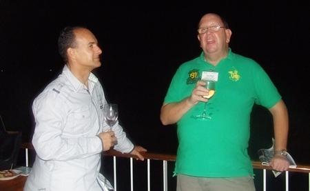 Les Nyerges (Capital TV) and Paul Whyte shoot the breeze on the terrace overlooking the beach.