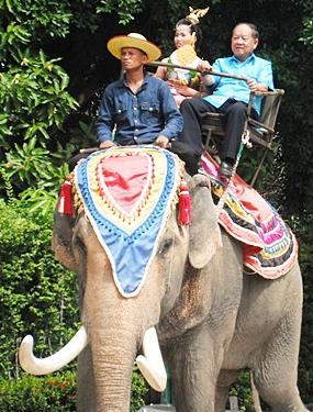 Nongprue Mayor Mai Chaiyanit arrives on the back of an elephant.