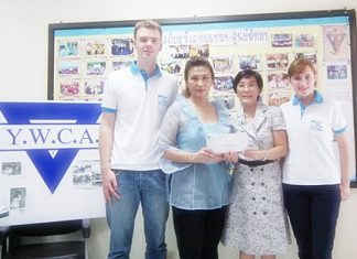 "Radchada ""Toy"" Chomjinda (2nd right), director of the HHN Foundation Thailand and HHN volunteers present funds to Nittaya Patimasongkroh (2nd left) to go towards the YWCA program to support poor students in local schools."