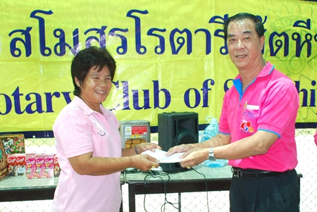 Rotary Club of Sattahip President Wirot Tuangcharuvinai presents a donation to Plutaluang's Wat Khao Bai Sri Special Education Center.