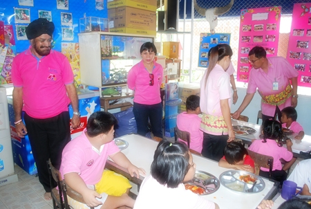 Rotarians provide lunch for the mentally challenged children.