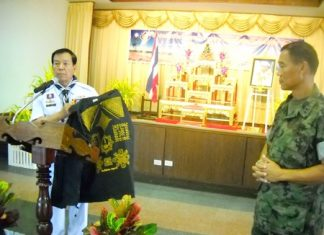 Rear Adm. Samak Noophairoj, scouts club president, presents vests covered in good luck symbols to Marine Corps Training Center commander, Vice Adm. Phongsak Phuririj.