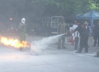 Employees of Grand Sole Hotel Pattaya Beach learn how to use a fire extinguisher.