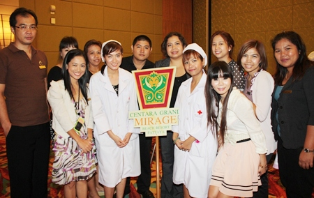 Daranat Nuchaikaew (centre right), director of human resources of Centara Grand Mirage Beach Resort Pattaya, led hotel staff to 'donate blood to give life' to the Thai Red Cross recently.  They were well cared for by Kanokwan Krisorn and Tidaprai Chatrawee (in white uniforms), two nurses from the National Blood Center (Region 3).