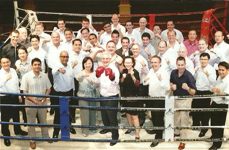 "Peter Henley (wearing red boxing gloves), president & CEO of Onyx Hospitality Group held a strategy meeting and hosted a dinner with all EVPs, VPs and general managers of Onyx Hospitality Group at Amari Watergate Bangkok recently. The motivational words were, ""Go for the knockout punch."""