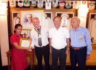 President Gudmund Eiksund (2nd left) inducts Lorena Paso (left) as the newest member of the Rotary Club of Jomtien-Pattaya during their regular meeting held in the Rotary Room at the Royal Cliff Grand Hotel recently. Lorena was proposed by PP Max Rommel (2nd right) and seconded by PP Dennis Stark (right) to be part of the wonderful Rotary world of humanitarian service and warm fellowship.