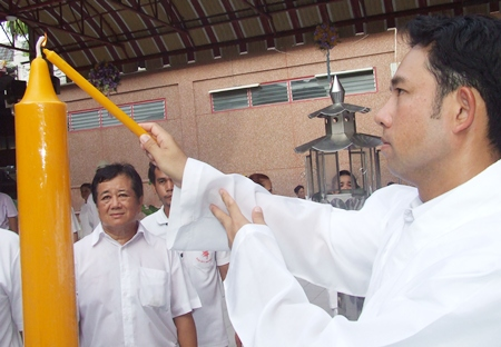 Mayor Itthiphol Kunplome lights some incense to summon different deities to impress upon the festival.
