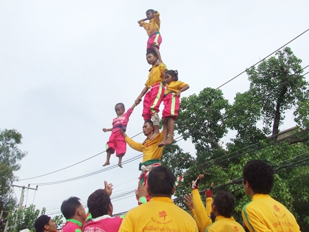 This human pyramid raises the children high into the sky.