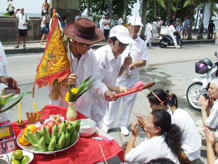 Business owners and residents who have put out worship altars along the parade route, present garlands and receive blessings for prosperity.