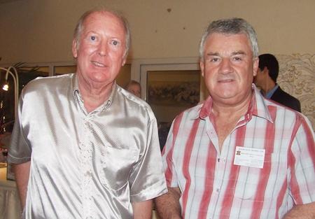 C. Morgan Jones and Roger D Ellis enjoy the social networking.