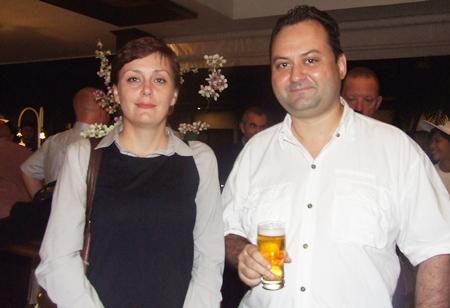 Elena Sayapina, marketing manager from Big Mango poses with fellow Russian Igor Burla.