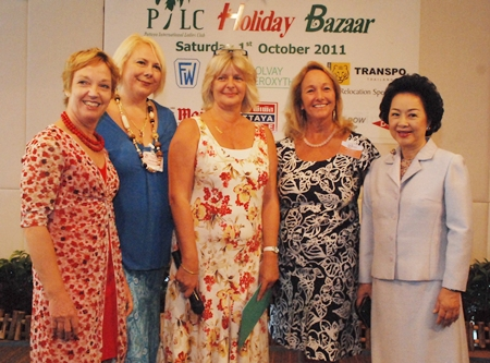 (L to R) Anja Schoof, vice president 2011 and president 2010; Celia Waters, president 1996, Bea Grunwell, president 2011; Rosanne Diamente, president 2007; and Panga Vathanakul, managing director of Royal Cliff Hotels Group pose for a group photo during the Pattaya International Ladies Club (PILC) annual Holiday Bazaar held at the Royal Cliff Hotels Group.