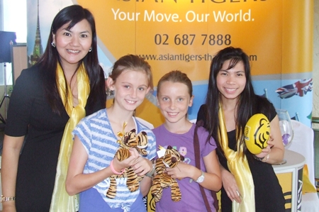 Youngsters win some pet tigers at the Asian Tiger stall.