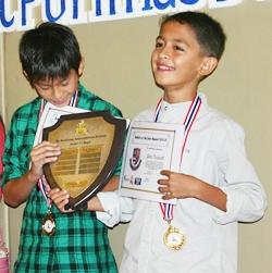 Oat (U11 Sportsmanship Award) and Qino (U11 Athlete Award) receive their awards.