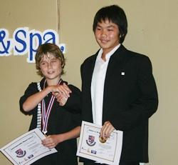 Declan (U13 Sportsmanship Award) and Im (U13 Athlete Award) receive their awards.