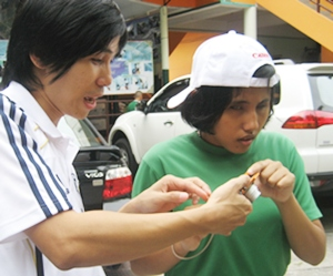 One of the blind students learning a new skill.