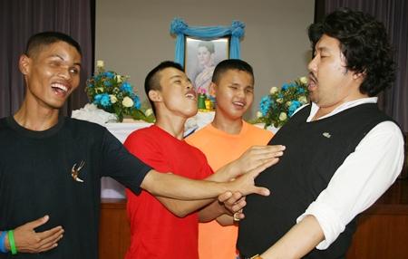 The choir learn to breathe properly with tenor Kim Jun Man.