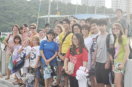 Primary and secondary students help carry out a huge beach cleaning operation.