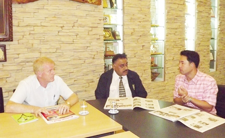 (L to R) Gudmund Eiksund, president of the Rotary Club of Jomtien-Pattaya, and Peter Malhotra, MD of the Pattaya Mail Media Group work with Mayor Itthiphol Kunplome on ways to help flood victims in Central Thailand.