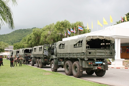 With dark skies as a backdrop, the navel convoy prepares to leave to assist flood-relief efforts in Ayutthaya.