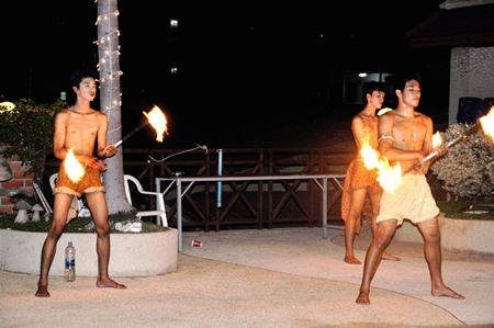 Fire twirlers are a big hit at the party.