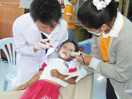 A little guy has his teeth checked by professional doctors from Bangkok Hospital Pattaya.