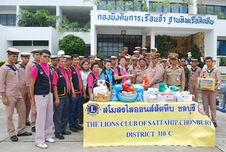 Sattahip Lions Club members donate spiritual books to officials to give to prisoners at the Sattahip Naval Base Penitentiary.
