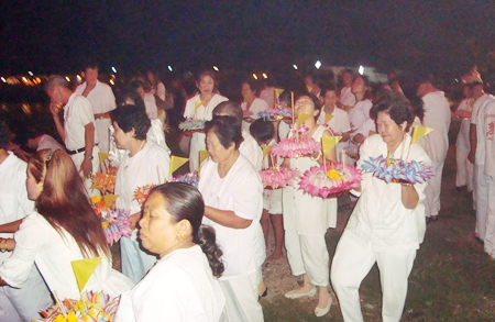 Sattahip residents head towards water to loy their krathongs.